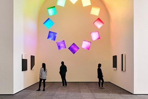 Austin by Ellsworth Kelly interior building installation showing interplay of light through colored glass as viewers observe